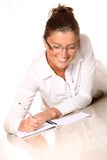 A young woman writing Royalty Free Stock Photo