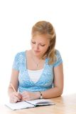 Young woman writing Stock Photos