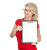 Young woman  writing on black clipboard Royalty Free Stock Photos