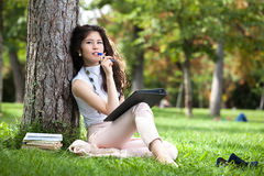 Young woman writing Royalty Free Stock Photos