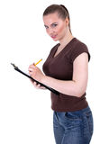Young woman writing on clipboard Stock Photography