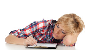Young woman writing on clipboard Royalty Free Stock Photography