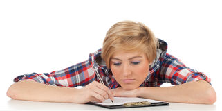 Young woman writing on clipboard Stock Photo