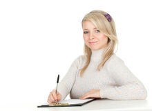 Young woman writing on clipboard Royalty Free Stock Images