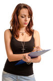 Young woman writing on a clipboard Royalty Free Stock Photos