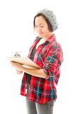 Young woman writing on clipboard isolated on white Royalty Free Stock Images
