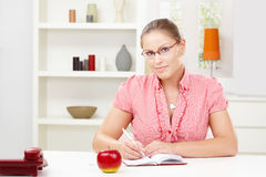 Young woman writing diary Royalty Free Stock Photography