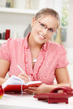 Young woman writing diary Stock Photos