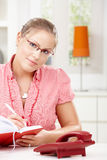 Young woman writing diary Stock Photo