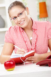 Young woman writing diary Stock Image