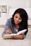 Young woman writing in diary Royalty Free Stock Photo