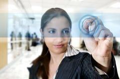 Young woman writing on digital touching Stock Photo