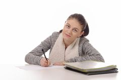 Young woman writing on her desk isolated on a white background Stock Photography