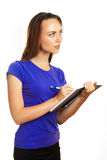 Young woman writing in her organizer Stock Image