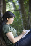 Young Woman Writing In Journal Stock Images