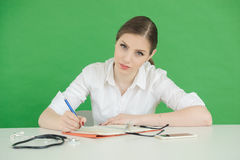 Young woman writing in journal or notebook Royalty Free Stock Photography
