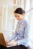 Young woman writing on laptop royalty free stock photo