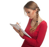 Young woman writing on notebook Royalty Free Stock Photos