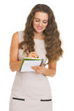 Young woman writing in notepad Stock Photo