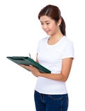 Young woman writing on the notepad Royalty Free Stock Photo