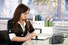 Young woman writing notes Stock Photo