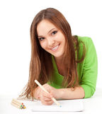 Young woman writing or painting Royalty Free Stock Photos