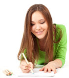 Young woman writing or painting Stock Photo