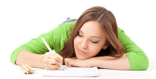Young woman writing or painting Stock Images