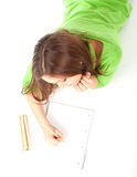 Young woman writing or painting Stock Photos