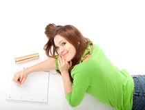 Young woman writing or painting Royalty Free Stock Image