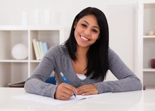Young woman writing on paper Stock Photo