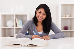 Young Woman Writing On Paper Stock Photos