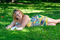 Young woman writing in a park Royalty Free Stock Photo