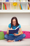 Young woman writing something in datebook. Smiley young woman writing something in datebook Stock Photo