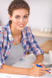 Young woman writing something in her note pad Royalty Free Stock Image