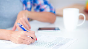 Young woman writing something in her note pad Royalty Free Stock Photos