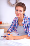 Young woman writing something in her note pad Royalty Free Stock Images