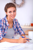 Young woman writing something in her note pad Stock Image