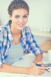 Young woman writing something in her note pad Royalty Free Stock Photography