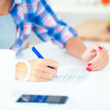 Young woman writing something in her note pad Stock Photo