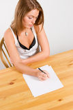 Young woman writing on table Royalty Free Stock Photography