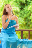 Young woman writing to notebook. Outdoor portrait Royalty Free Stock Photography