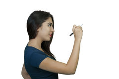 Young woman writing Royalty Free Stock Images