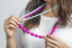 Young woman's holding colorful beads in her hands Royalty Free Stock Photo