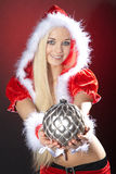 Young woman with xmas ball Royalty Free Stock Image