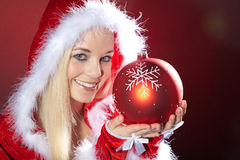 Young woman with xmas ball Stock Photo