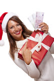 Young woman with an Xmas gift and money Royalty Free Stock Photo