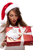 Young woman with an Xmas gift and money Stock Photos