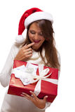 Young woman with an Xmas gift and money Royalty Free Stock Photography