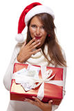 Young woman with an Xmas gift and money Royalty Free Stock Images